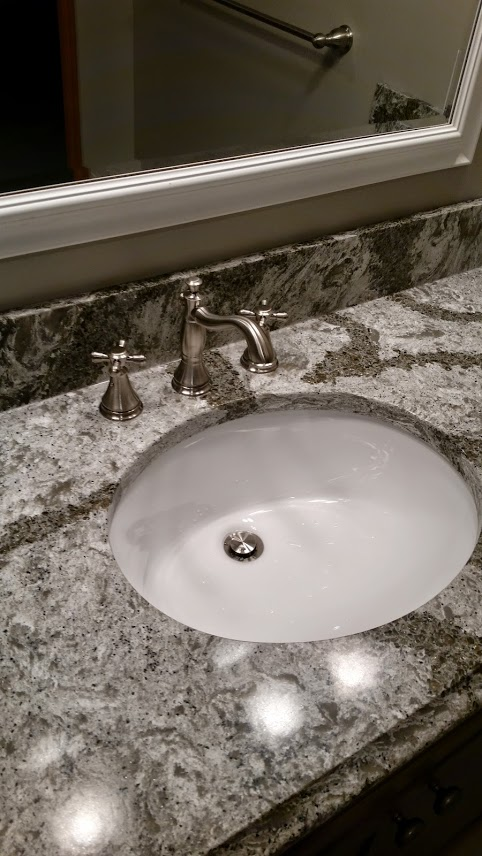Cambria countertop with Delta faucet