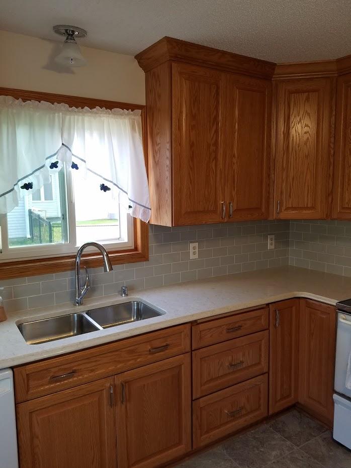 raised panel oak kitchen cabinets