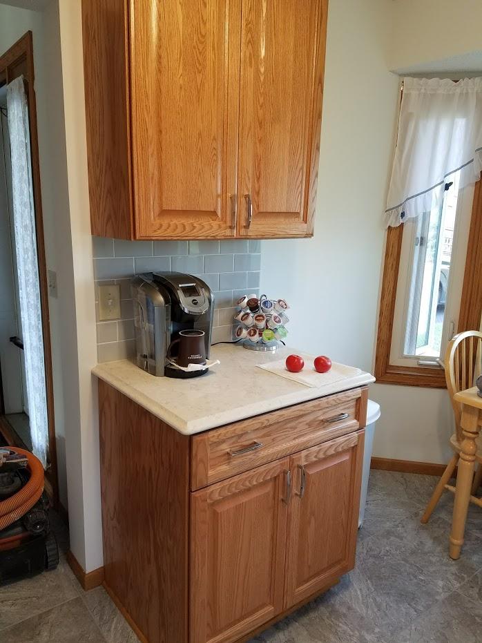 oak cabinets with quartz countertops
