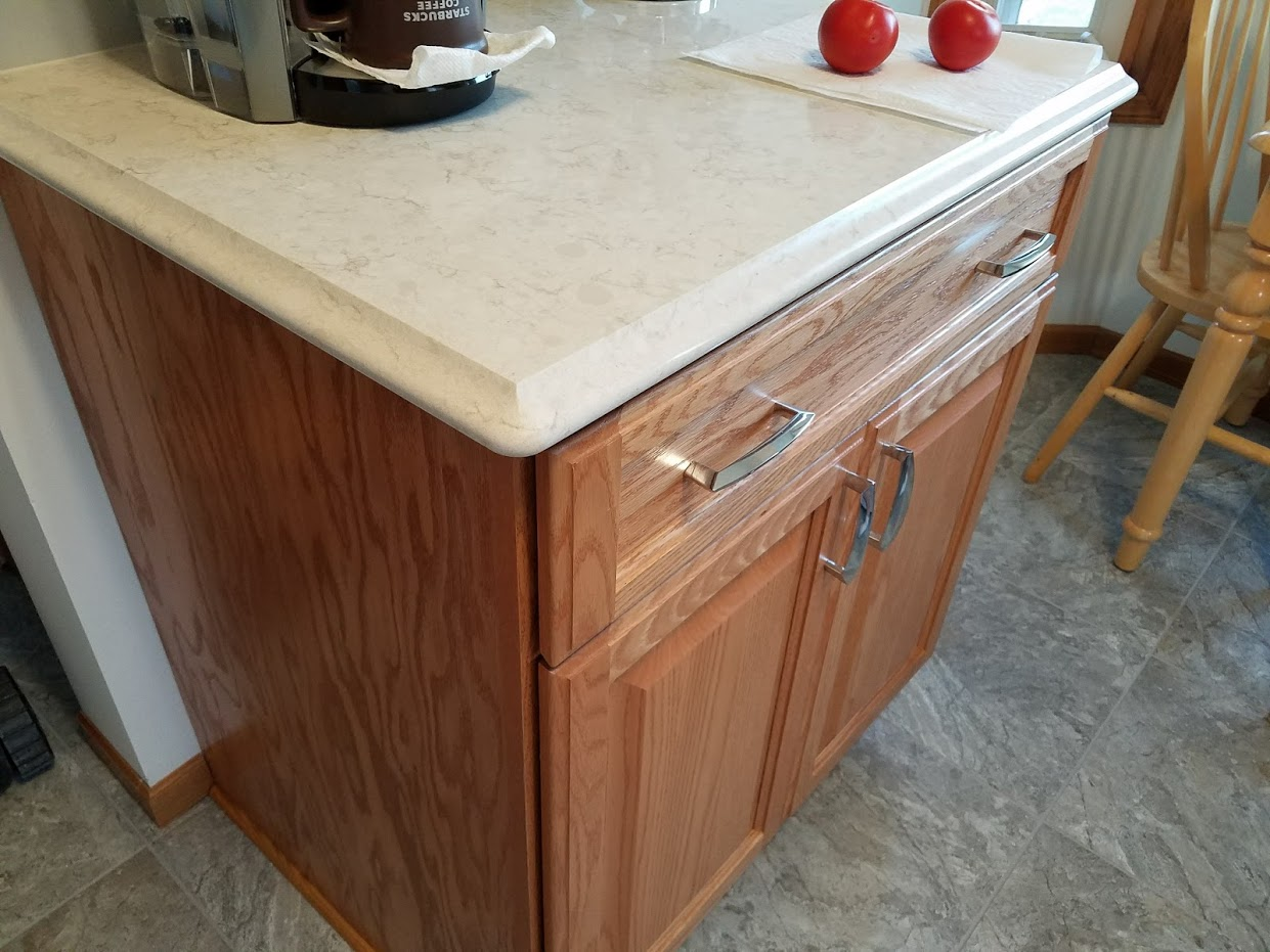 oak kitchen cabinet with quartz countertop