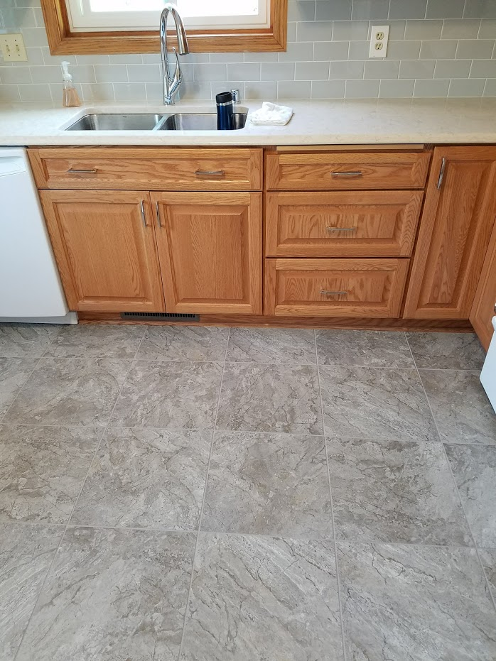 Oak cabinets, luxury vinyl tile floor
