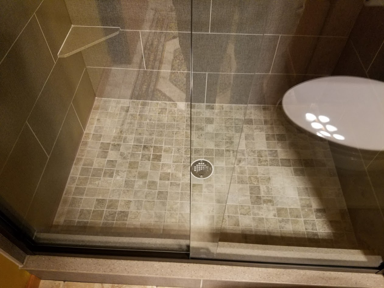 shower tile floor and glass door