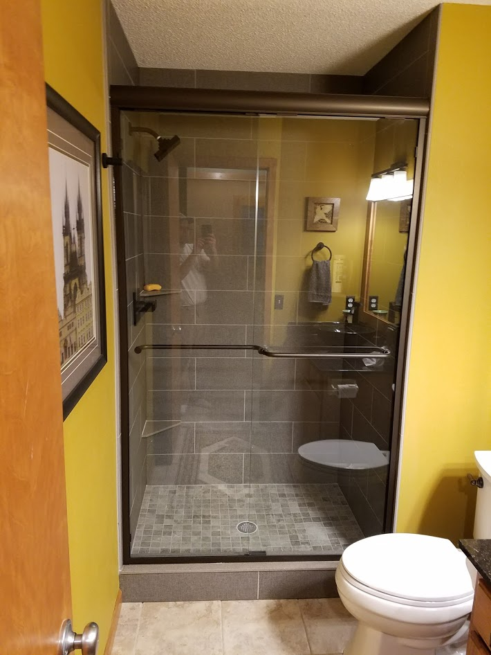 shower with textile pattern tile and glass door