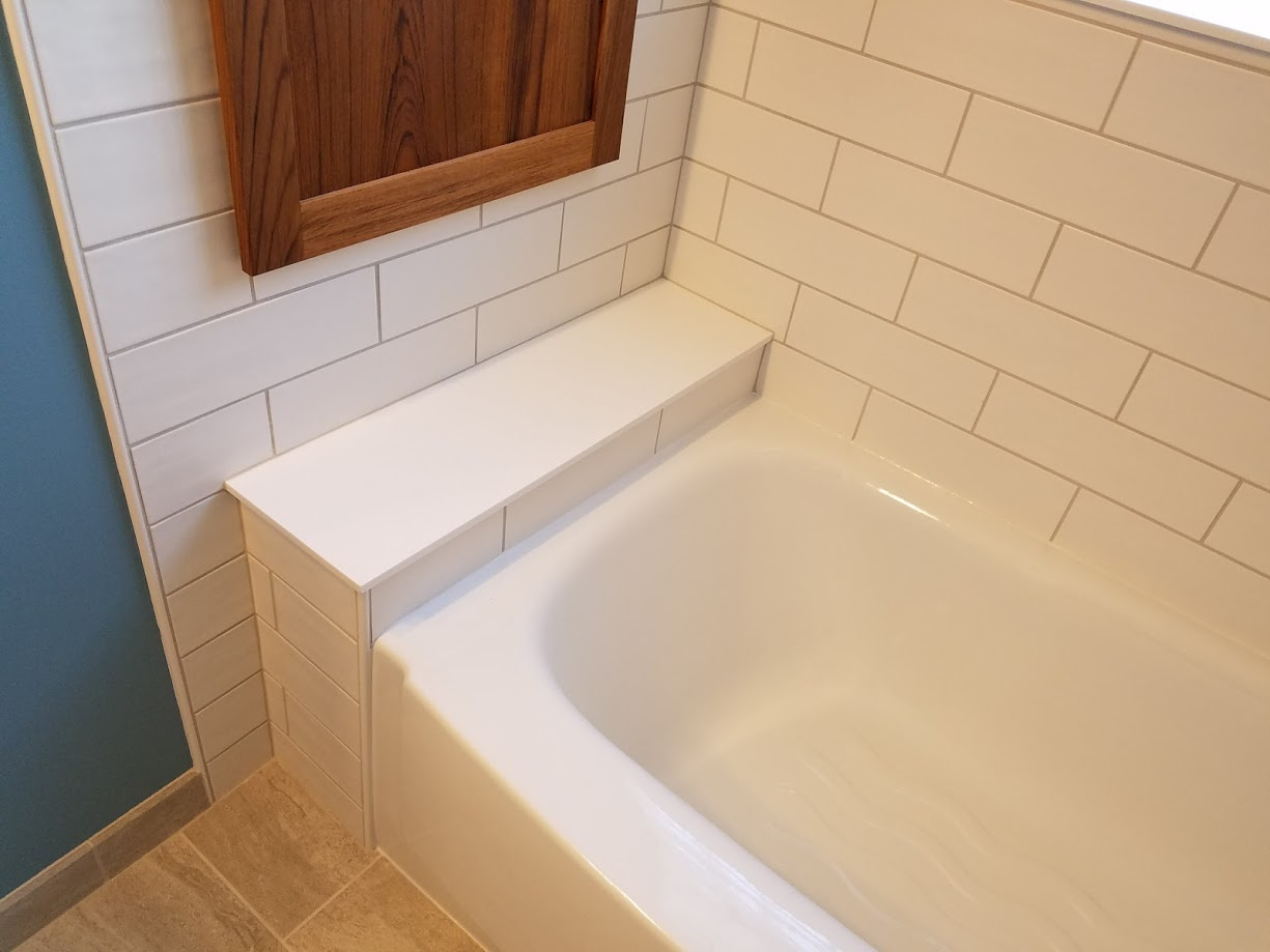 bathtub ledge and white subway tile
