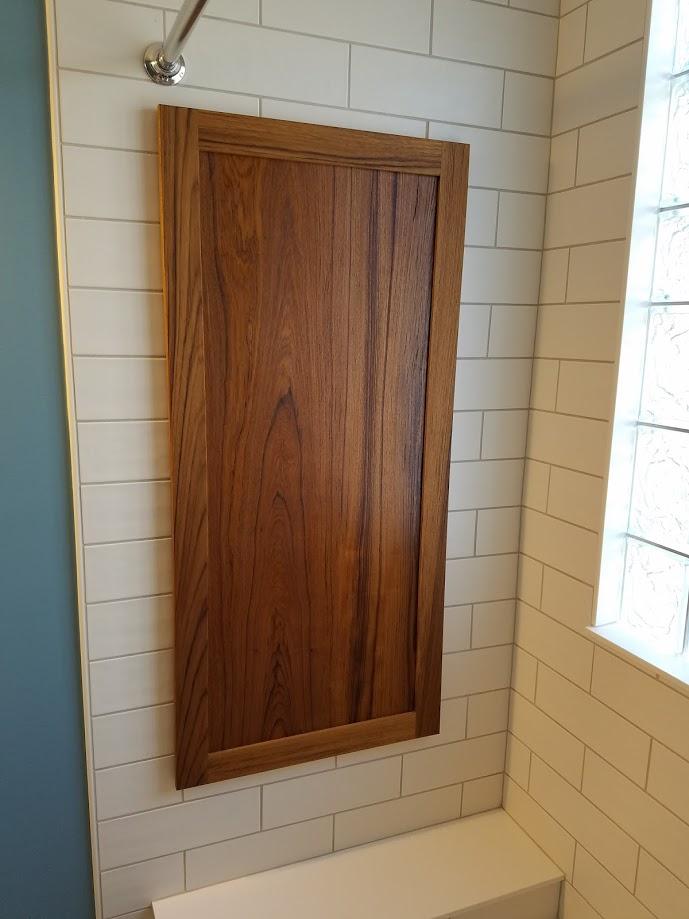 teak cabinet door and white subway tile