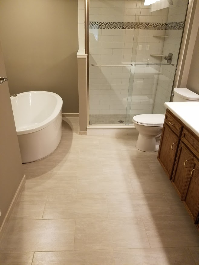 Bathroom with tile floor and shower
