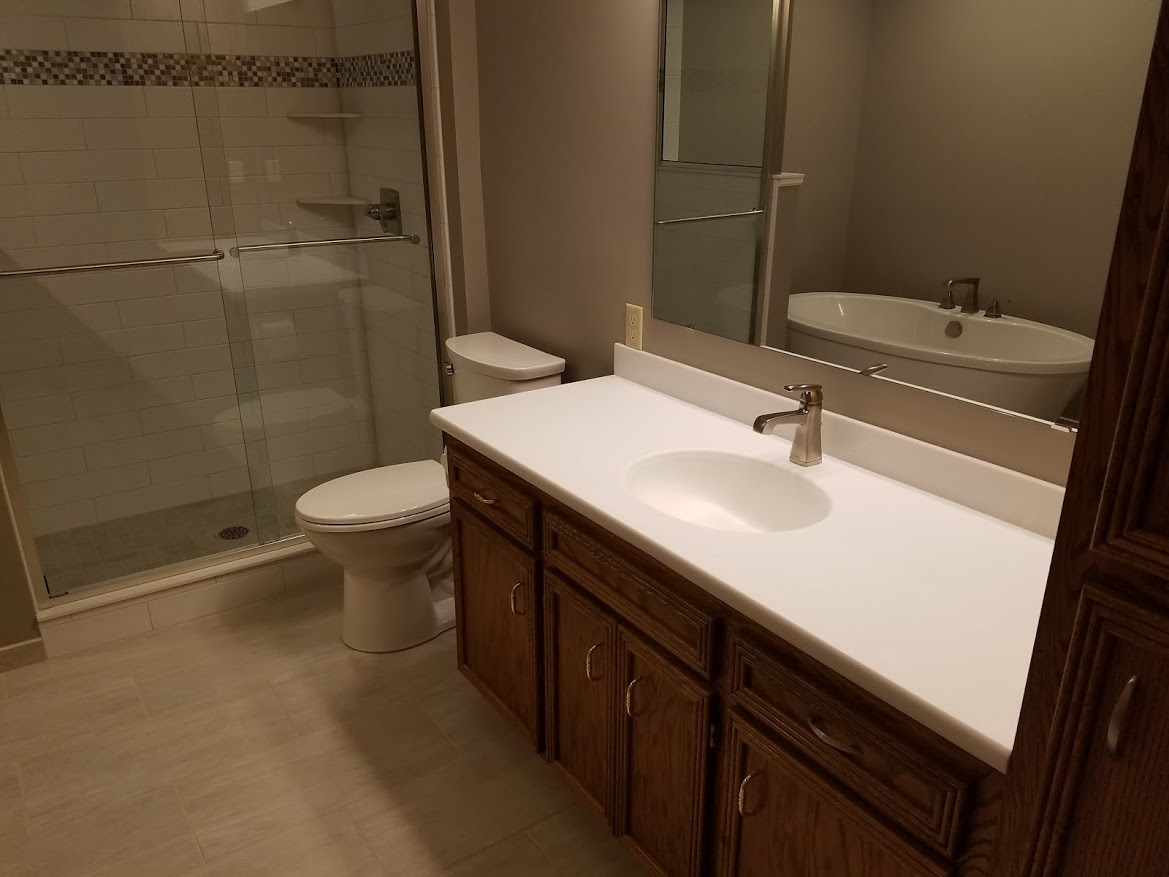 Bathroom with oak cabinet and Corian countertop