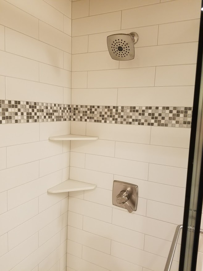 Tile shower with Delta faucet