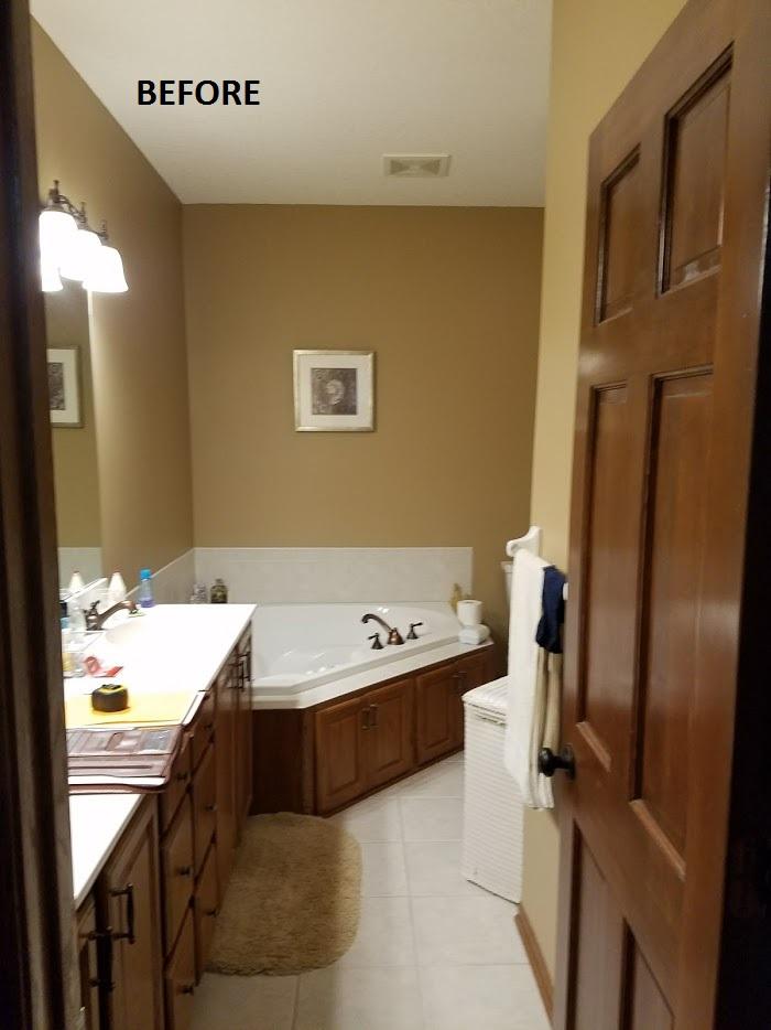 bathroom with corner whirlpool tub