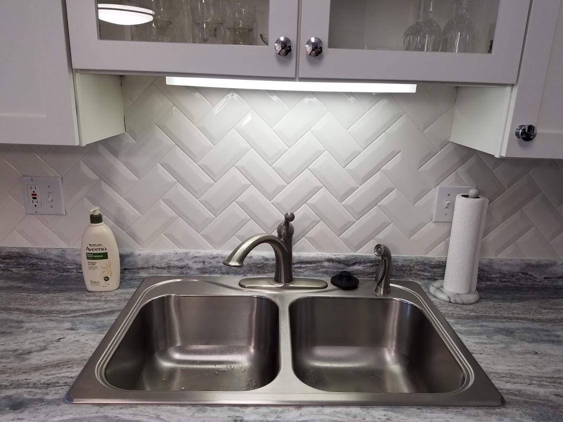 Herringbone tile backsplash